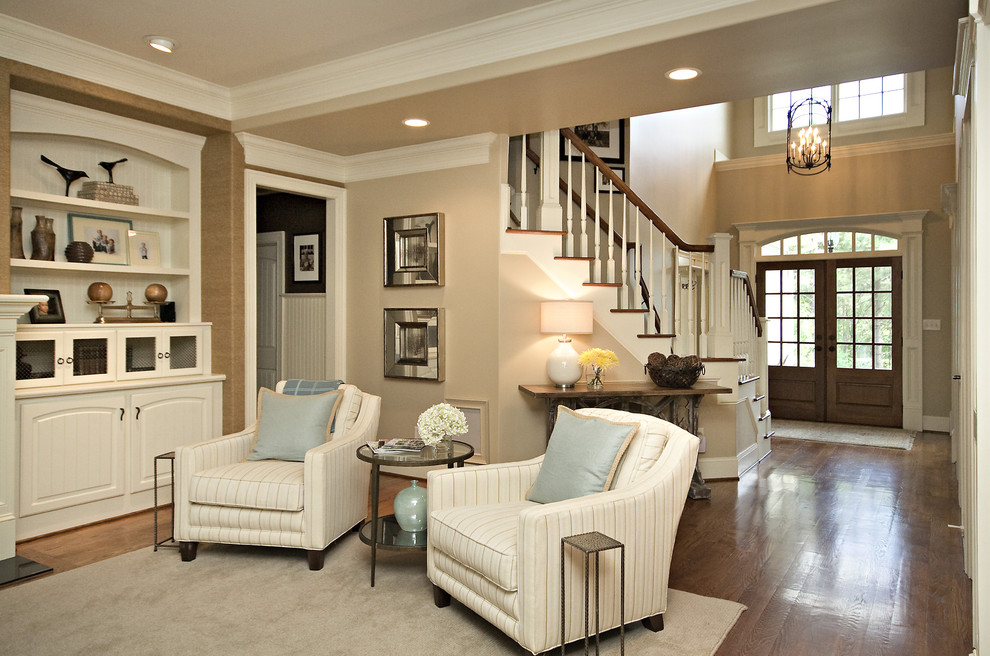 Family room - traditional dark wood floor family room idea in Raleigh with beige walls