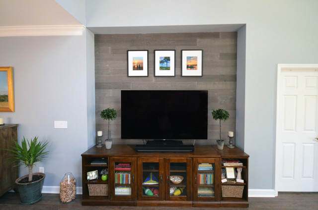 Coastal family room photo in Charlotte with a wall-mounted tv