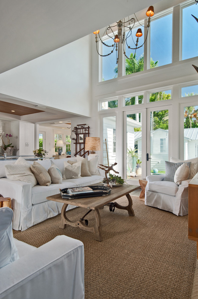 Family room - mid-sized coastal open concept dark wood floor family room idea in Miami with white walls and a wall-mounted tv