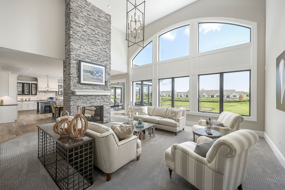Family room - mid-sized transitional enclosed carpeted and gray floor family room idea in Chicago with a stone fireplace, beige walls, a two-sided fireplace and no tv