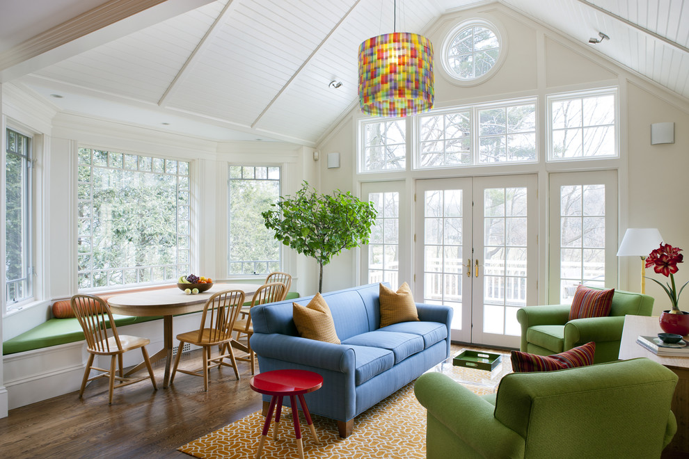 Family room - eclectic medium tone wood floor family room idea in Boston with beige walls and no fireplace