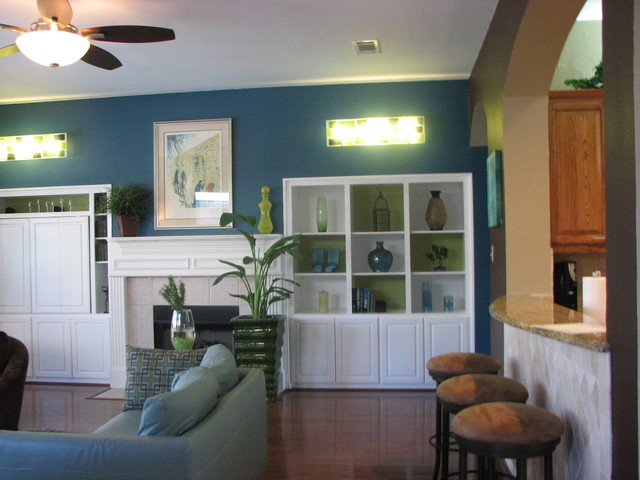 Color behind bookshelves contemporary-family-room