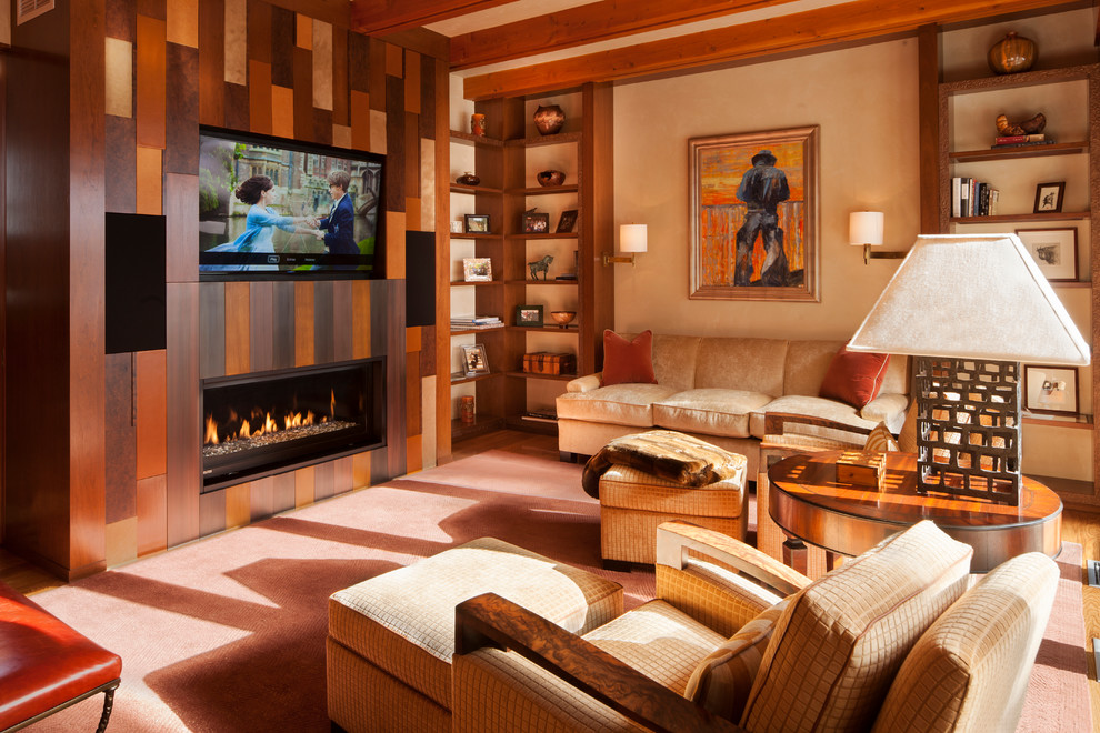 Inspiration for a transitional family room remodel in Philadelphia with beige walls, a ribbon fireplace and a wall-mounted tv
