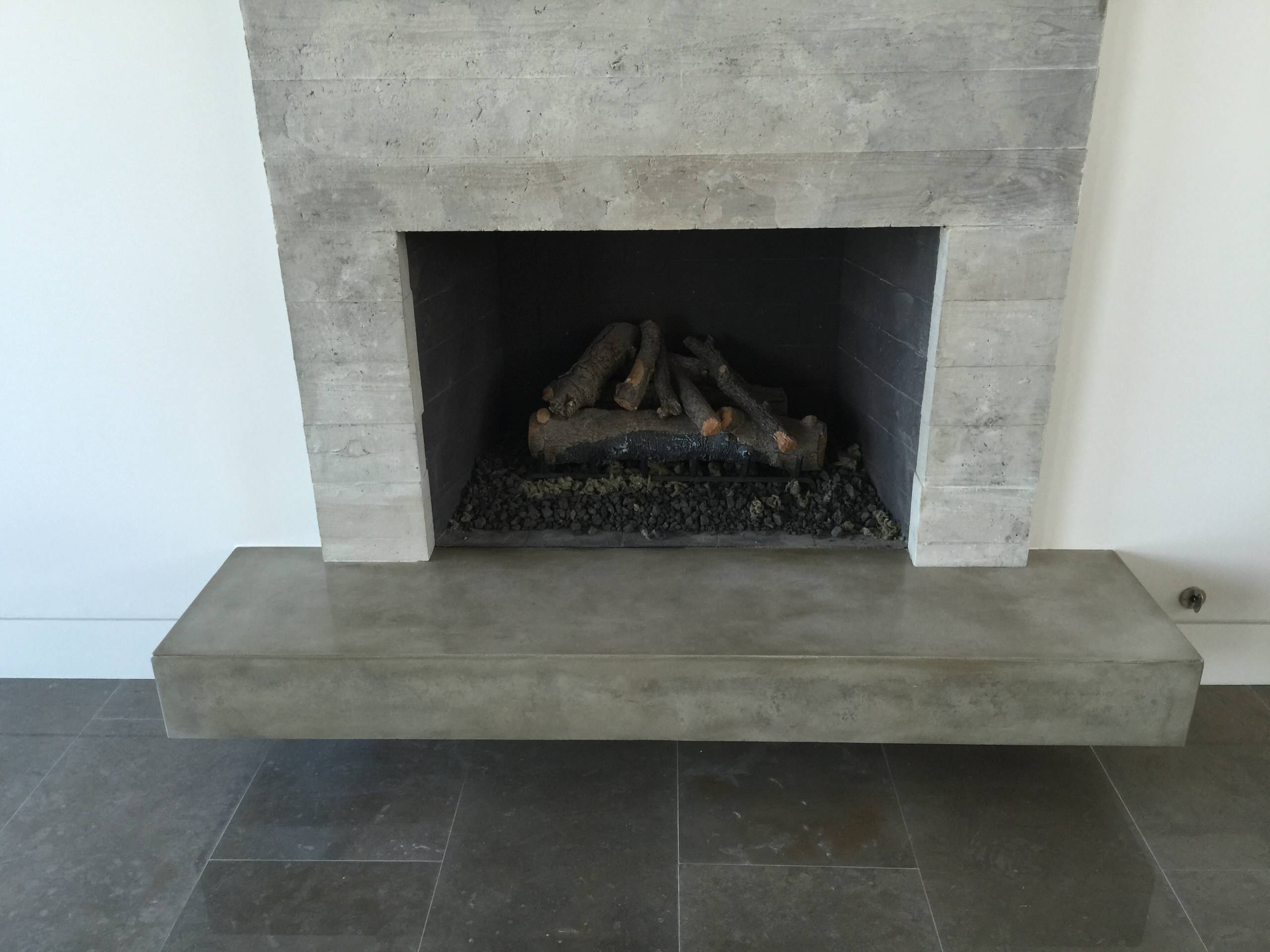 Concrete board formed veneer tile fireplace surround and floating ...
