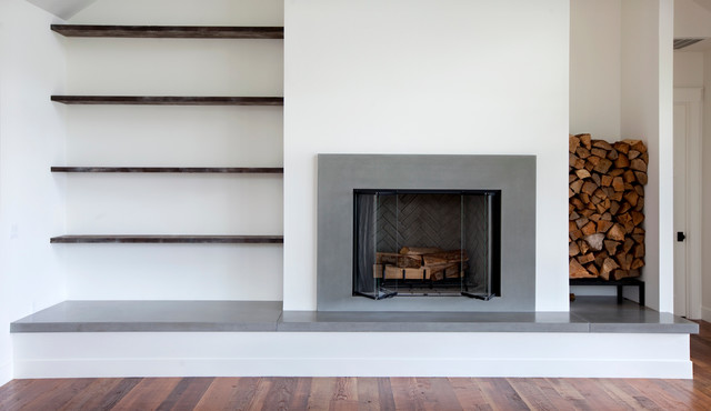 Concrete Fireplace modern-family-room