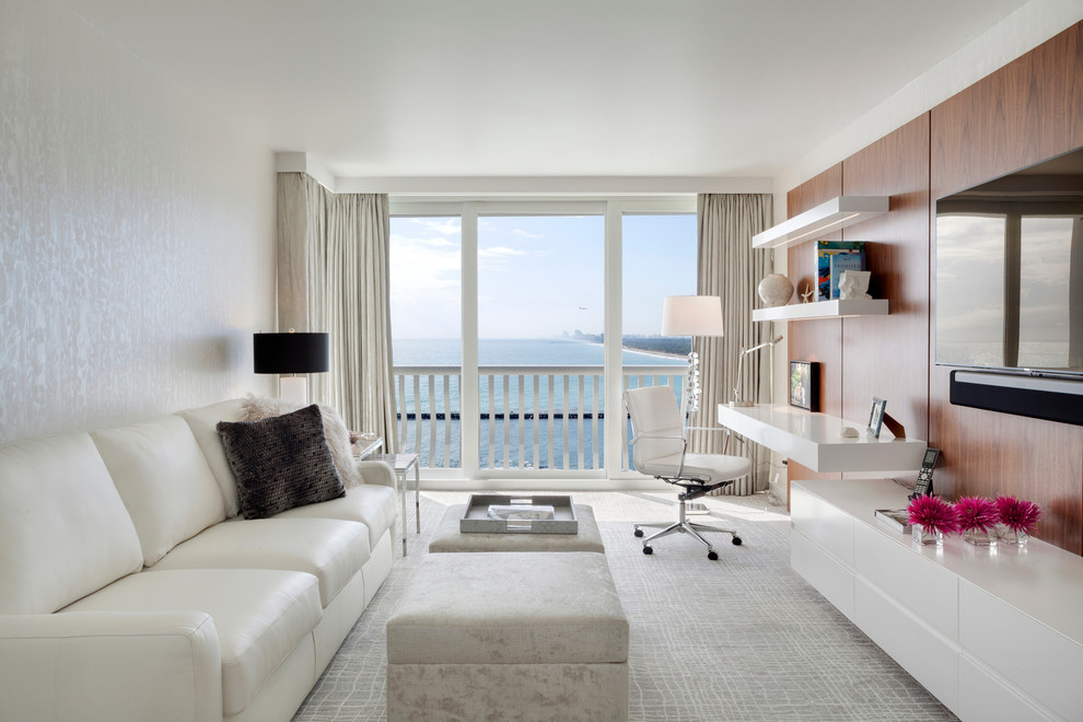 Family room - contemporary carpeted family room idea in Miami with white walls, no fireplace and a wall-mounted tv