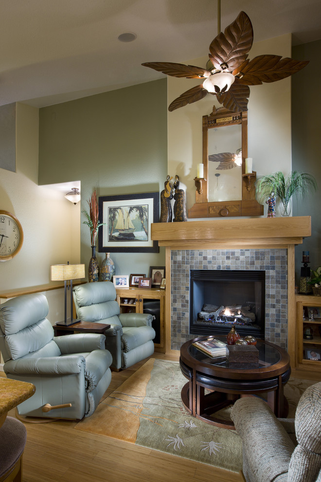 Example of a mid-sized eclectic open concept bamboo floor family room design in Sacramento with a tile fireplace, green walls and a standard fireplace