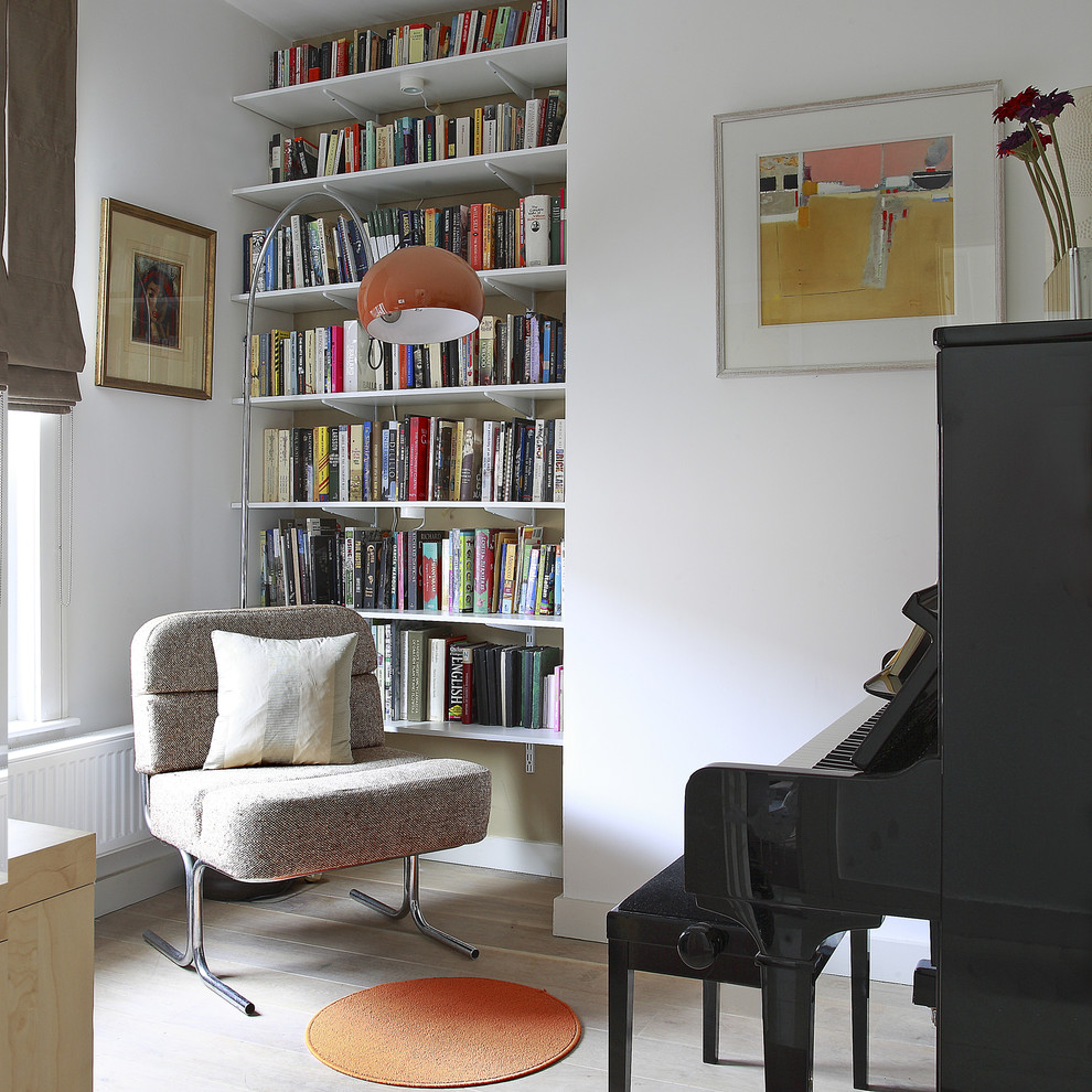 Small trendy family room photo in Dublin with a music area