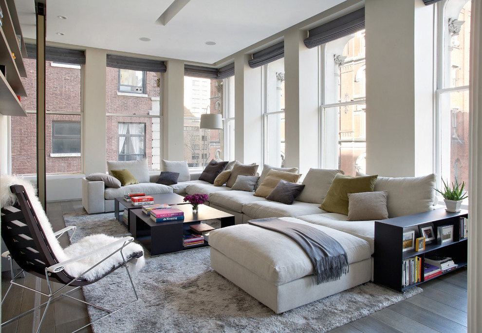 Family room - contemporary family room idea in New York with white walls