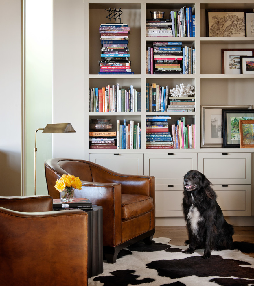 Example of a trendy family room library design in Seattle