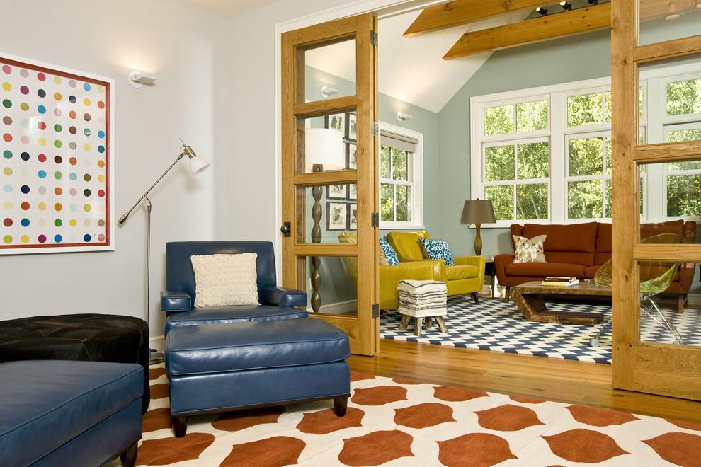 Trendy medium tone wood floor family room photo in Other