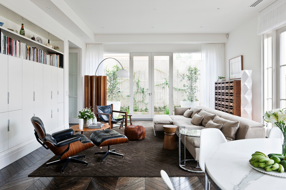 Family room - large contemporary open concept dark wood floor family room idea in Melbourne with white walls