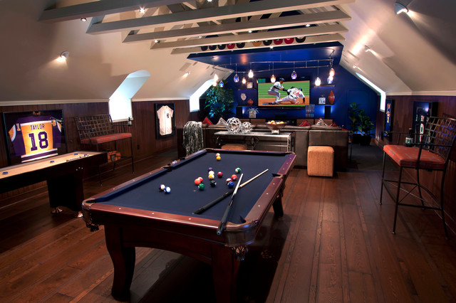 Trendy brown floor game room photo in Other with blue walls