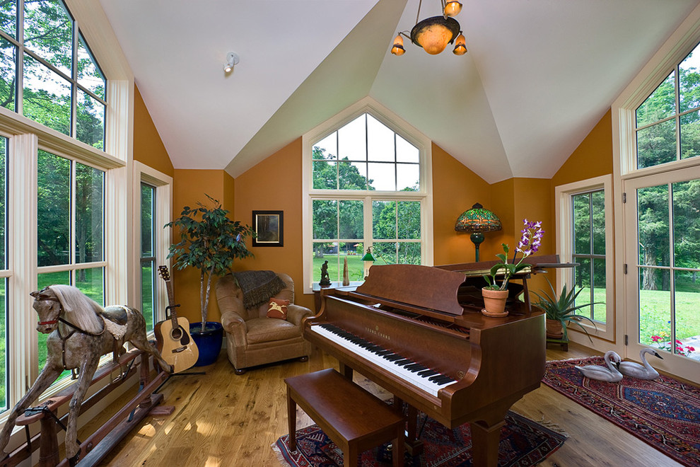 Trendy family room photo in Boston with a music area