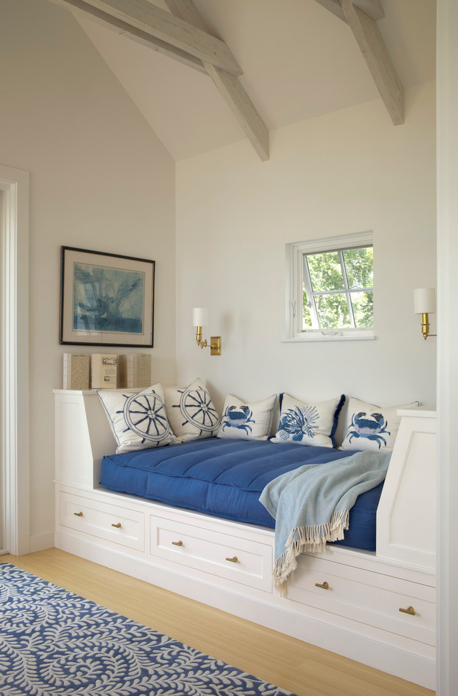Example of a beach style light wood floor family room design in Portland Maine with white walls