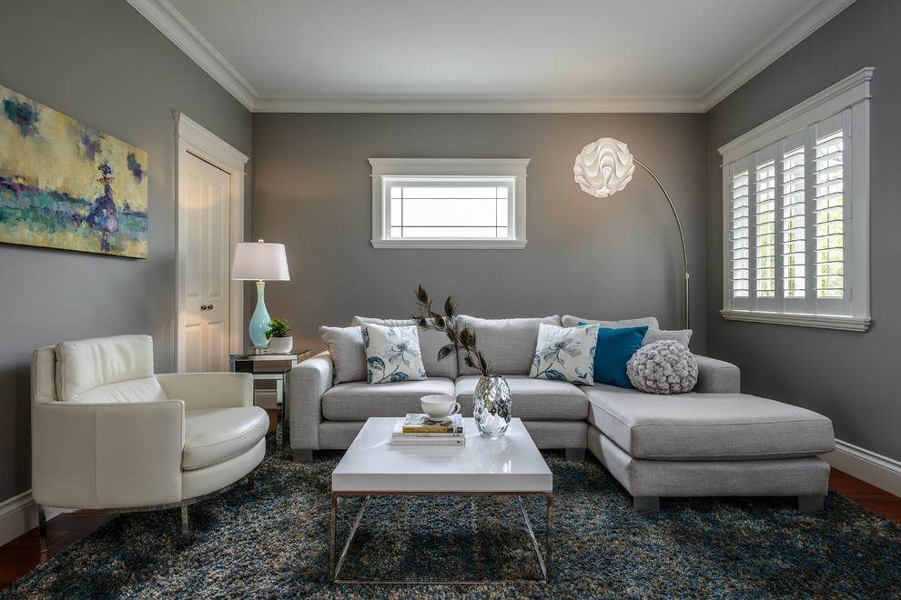 Inspiration for a mid-sized contemporary enclosed dark wood floor and brown floor family room remodel in Vancouver with gray walls, no fireplace and no tv