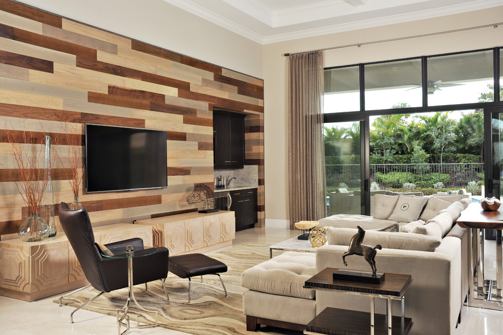 Family room - large contemporary open concept marble floor family room idea in Miami with a bar, a wall-mounted tv, beige walls and no fireplace
