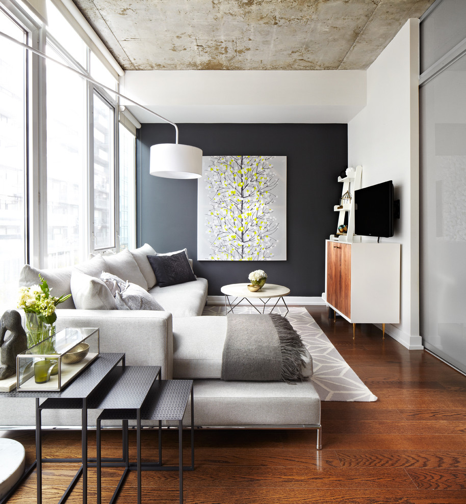 Inspiration for a mid-sized contemporary family room remodel in Dallas with black walls, no fireplace and a wall-mounted tv