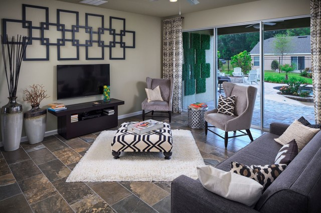 Example of a trendy slate floor family room design in Orlando