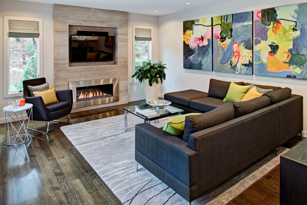 Inspiration for a contemporary family room remodel in New York with white walls, a ribbon fireplace and a wall-mounted tv