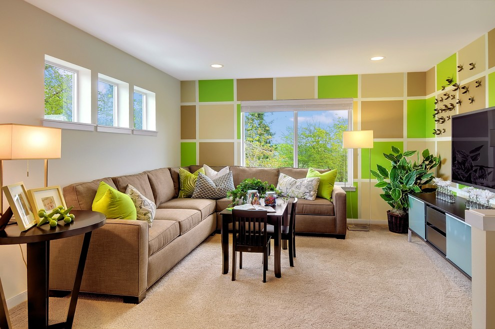 Example of a trendy carpeted family room design in Seattle with green walls and a wall-mounted tv