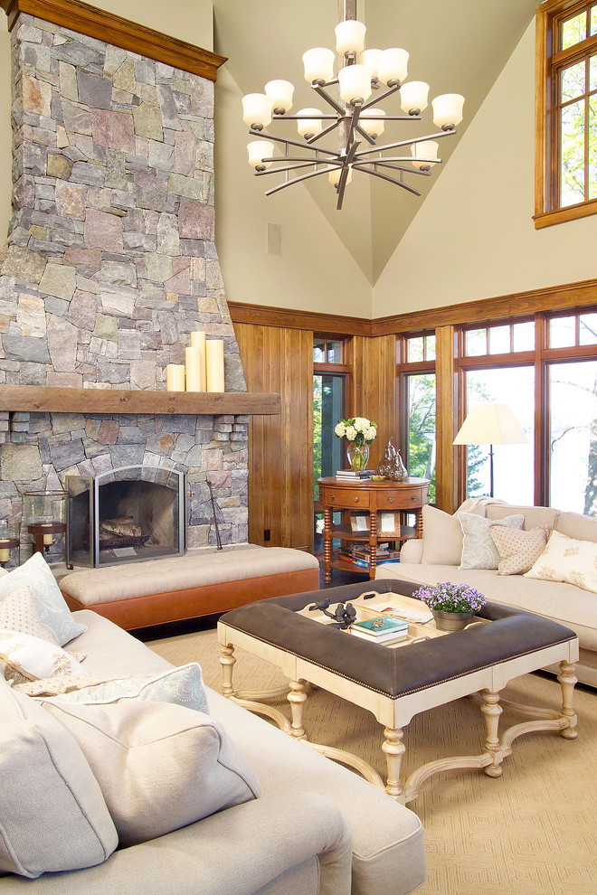 Inspiration for a contemporary family room remodel in Toronto with beige walls, a standard fireplace and a stone fireplace
