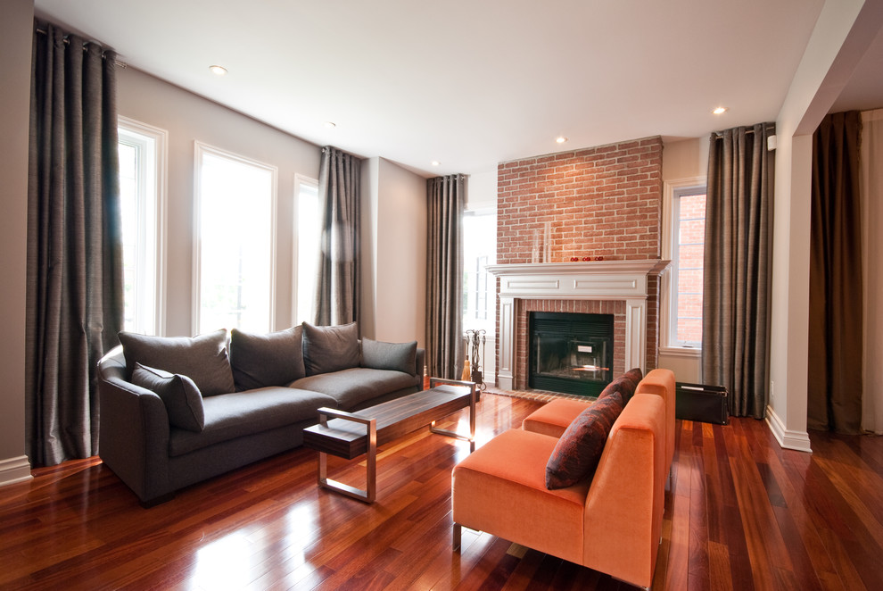 Example of a trendy family room design in Other with a brick fireplace