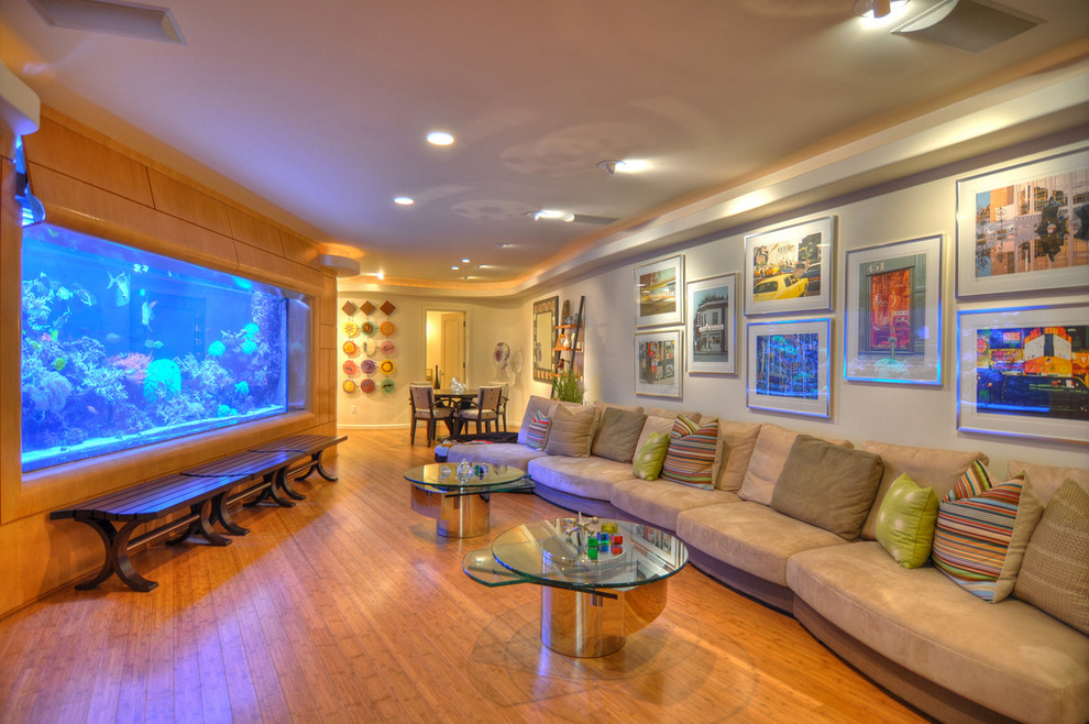 Inspiration for a contemporary medium tone wood floor family room remodel in Orange County with beige walls and no tv