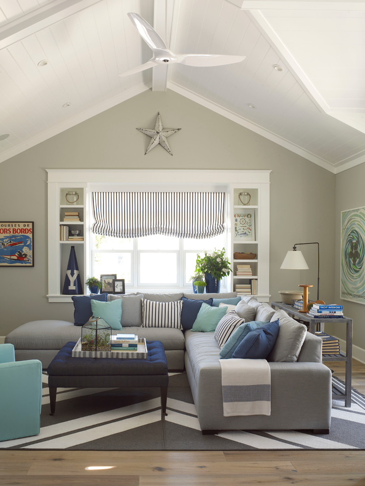 Inspiration for a large coastal light wood floor family room remodel in San Diego with gray walls