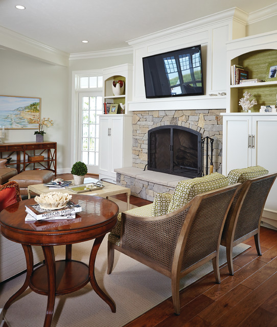 Family room - beach style family room idea in Grand Rapids with a standard fireplace, a stone fireplace and a wall-mounted tv