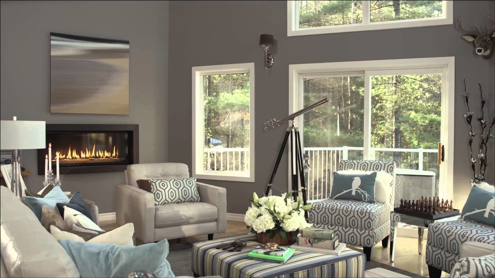 Large trendy light wood floor family room photo in Toronto with gray walls, a ribbon fireplace and a plaster fireplace