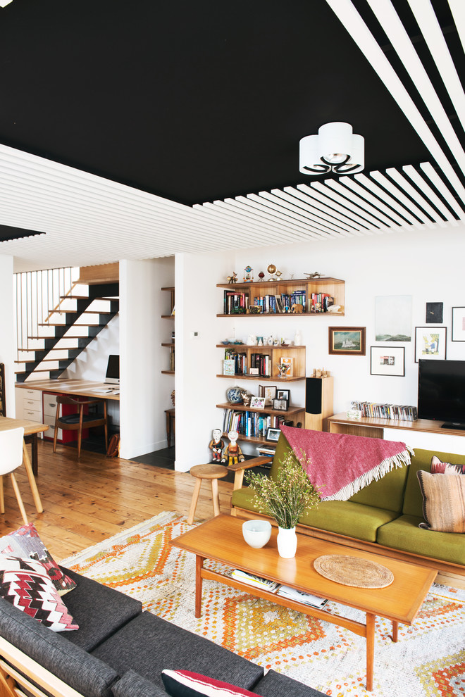 Mid-sized danish open concept light wood floor family room photo in Melbourne with white walls