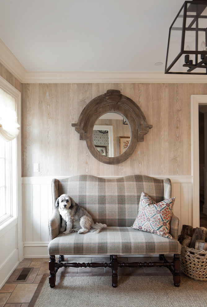 Inspiration for a large timeless medium tone wood floor family room remodel in New York with beige walls