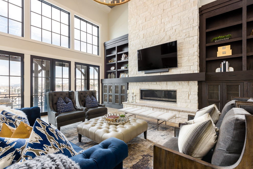 Example of a large transitional open concept light wood floor and brown floor family room design in Salt Lake City with beige walls, a stone fireplace, a wall-mounted tv and a ribbon fireplace