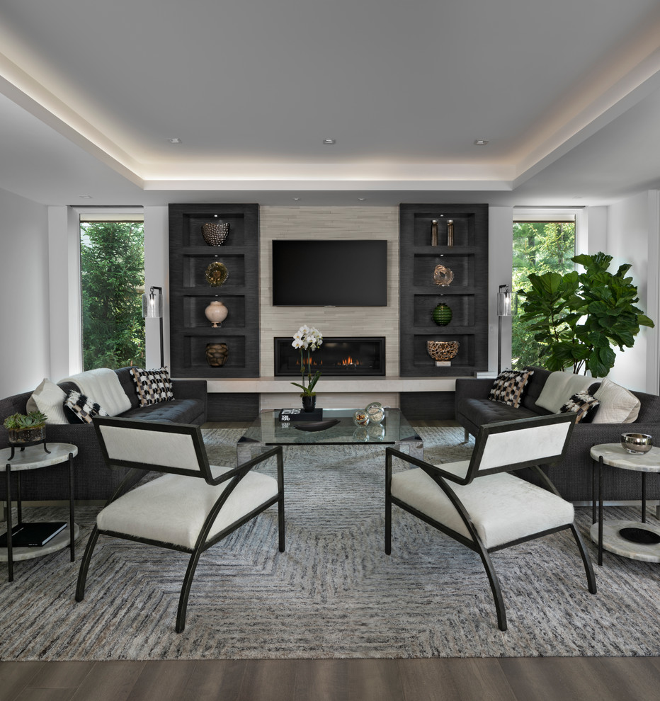 Inspiration for a contemporary brown floor family room remodel in Detroit with white walls, a ribbon fireplace and a wall-mounted tv