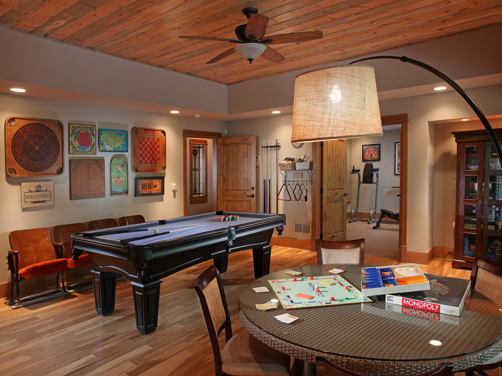 Game room - large traditional enclosed medium tone wood floor game room idea in Atlanta with gray walls and no fireplace