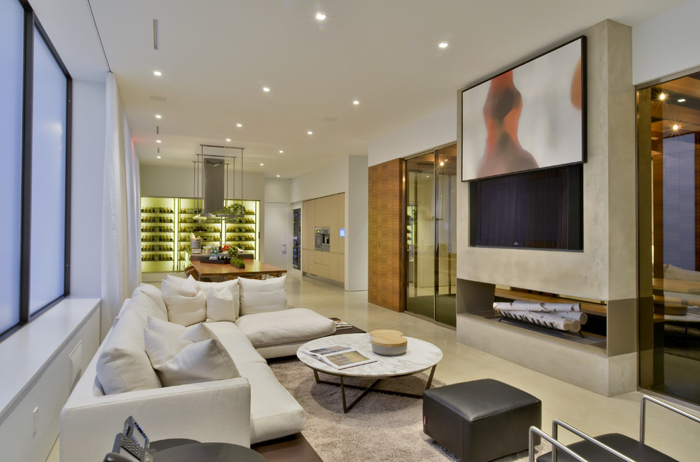 Inspiration for a contemporary open concept family room remodel in New York with white walls, a two-sided fireplace and a wall-mounted tv