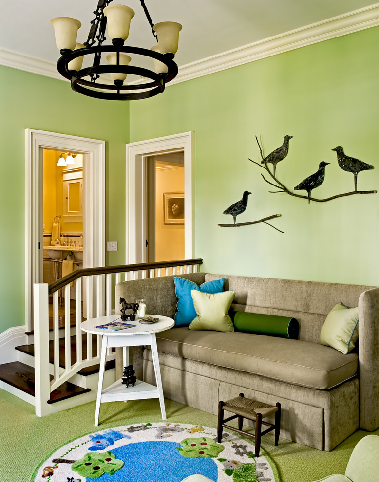 Example of a classic family room design in New York with green walls