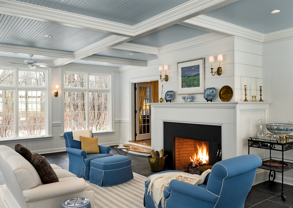 Elegant family room photo in New York with white walls