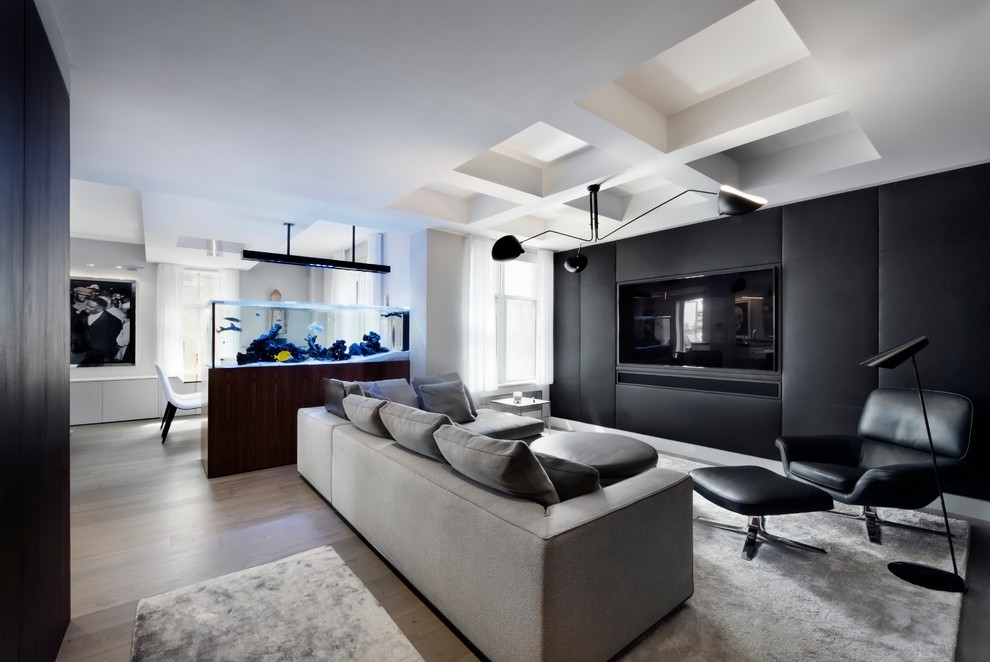 Inspiration for a contemporary open concept family room remodel in New York with black walls and a wall-mounted tv