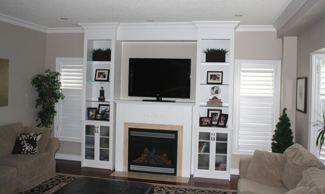 Custom built in wall unit traditional family room for Built in wall units