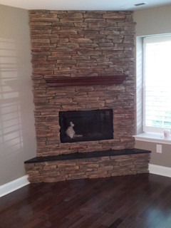 Custom corner stone direct fireplace craftsman family for Craftsman gas fireplace
