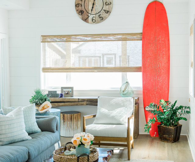 Family room - beach style light wood floor family room idea in San Diego with white walls