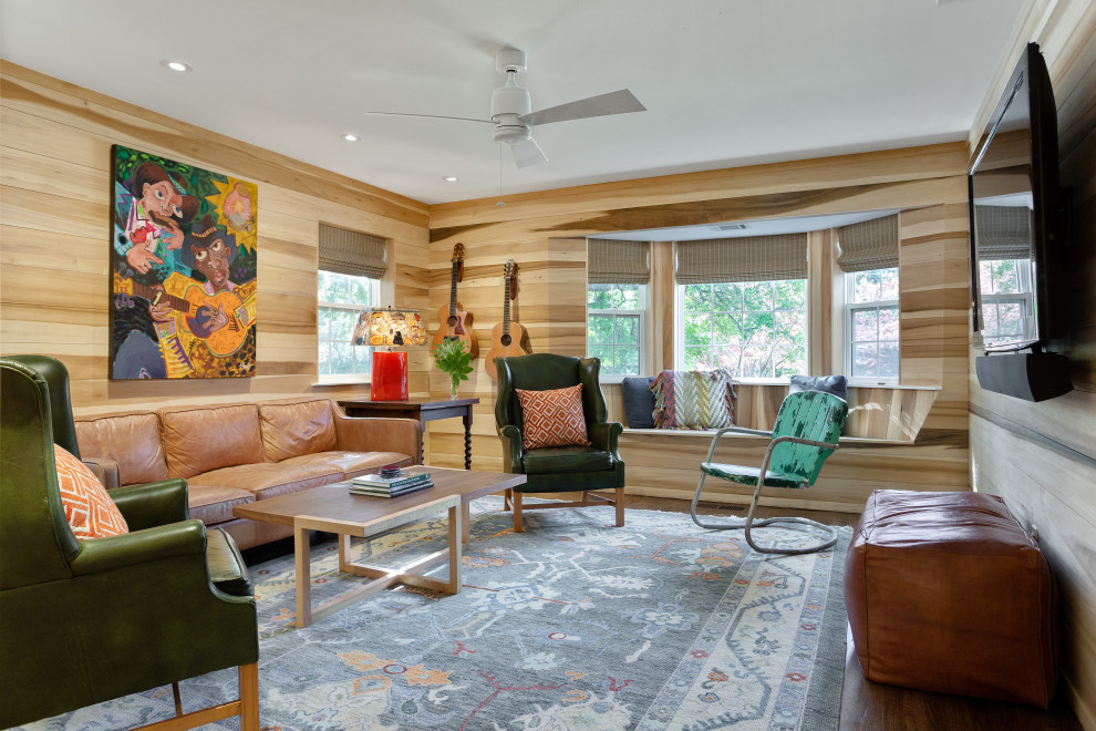 Small eclectic enclosed medium tone wood floor and brown floor family room photo in Dallas with brown walls and a wall-mounted tv