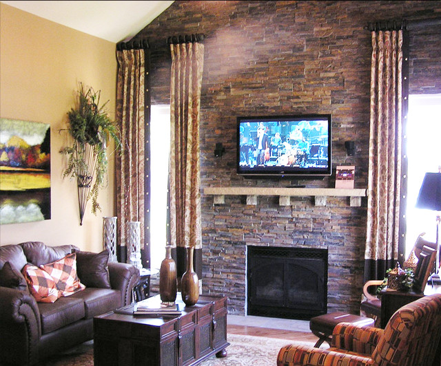 Dark Stone Fireplace To The Ceiling Traditional Family