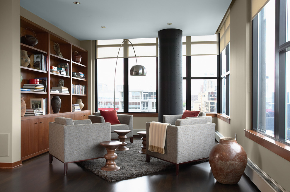 Example of a trendy open concept dark wood floor and brown floor family room library design in Minneapolis with beige walls, no fireplace and no tv