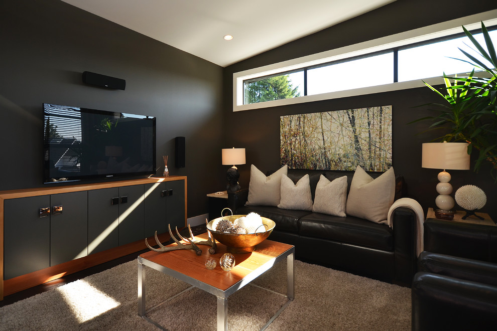 Trendy family room photo in Vancouver with black walls and a tv stand