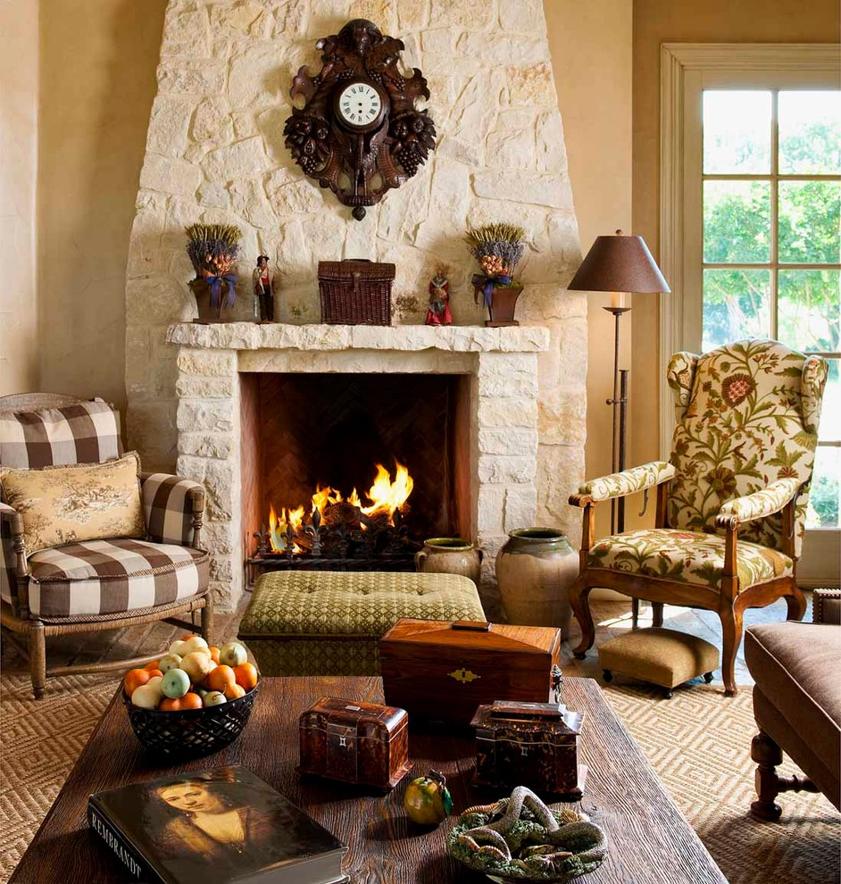 Example of a mountain style open concept family room design in Dallas with a standard fireplace, a stone fireplace, beige walls and a media wall