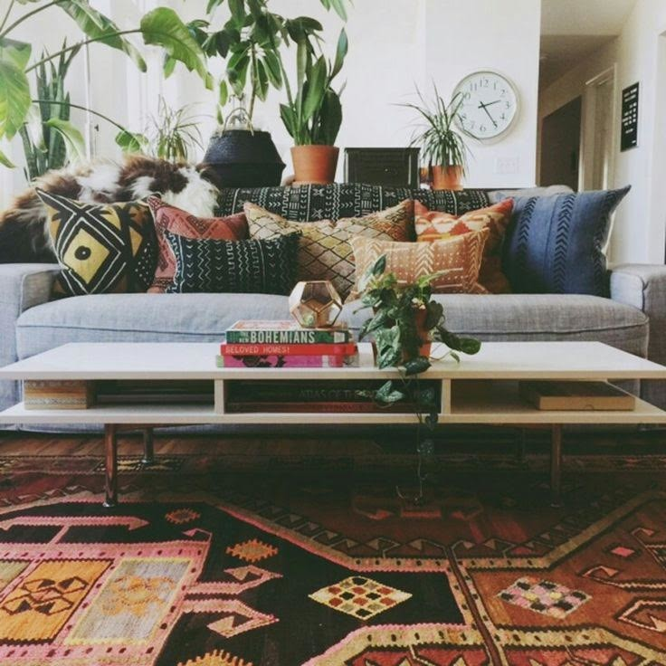 Inspiration for a mid-sized mid-century modern open concept medium tone wood floor and brown floor family room remodel in Other with white walls