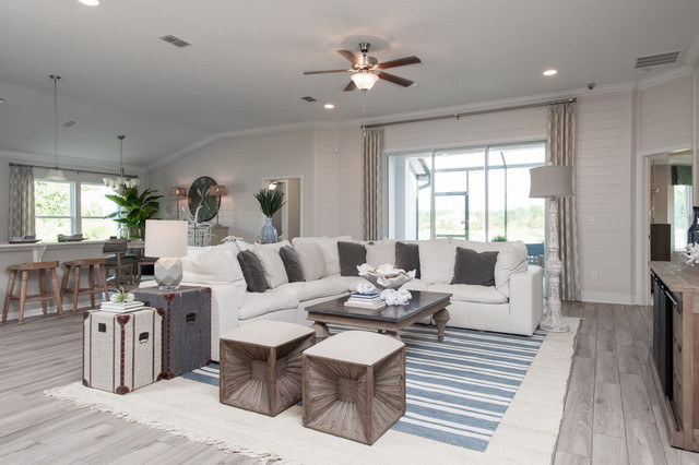 Large coastal open concept ceramic floor and beige floor family room photo in Jacksonville with white walls and a wall-mounted tv